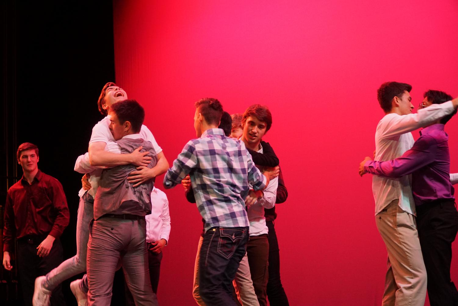 In this photo taken by Shorecrest student David Pike, the Mr. Shorecrest contestants rejoiced after their successful show. They congratulate each other after a long night of performances as possibly the last Mr. Shorecrest comes to an end.