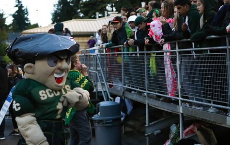 Otis hypes up fans at a Shorecrest Football game.