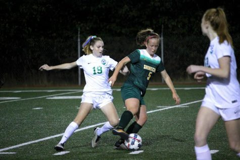 Senior captain Laura Hoover steals the ball from an opponent.