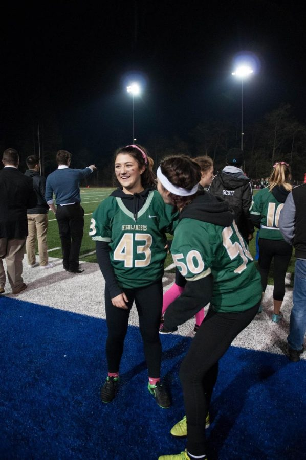 Senior Nina Leon poses after the senior girl's victory at Powderpuff.