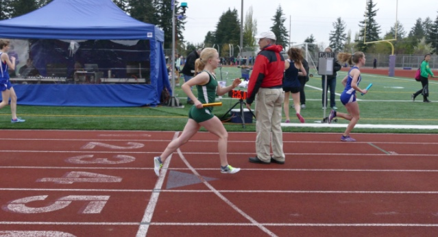 Gamble running the 4x800 meter relay at the Lake Washington Girls Invitational where she placed second, and set the school record.