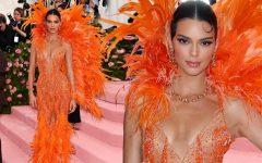 Kendall Jenner rocks a blazing orange piece.