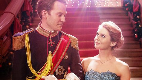"Princess Emily and Prince Richard share a romantic moment in ""A Christmas Prince."""